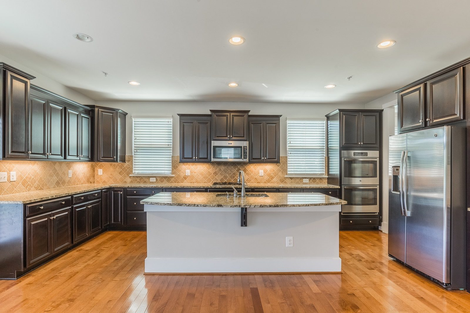 Potomac Shores quick move-in home with wooded views