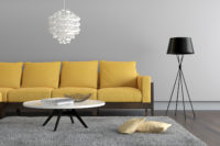 photo of a room with a beautiful yellow couch
