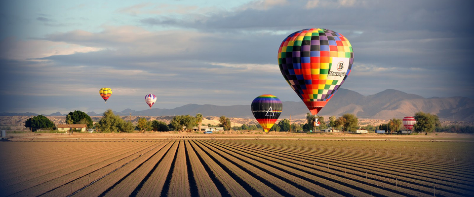 Balloons descend into the fields 960x400