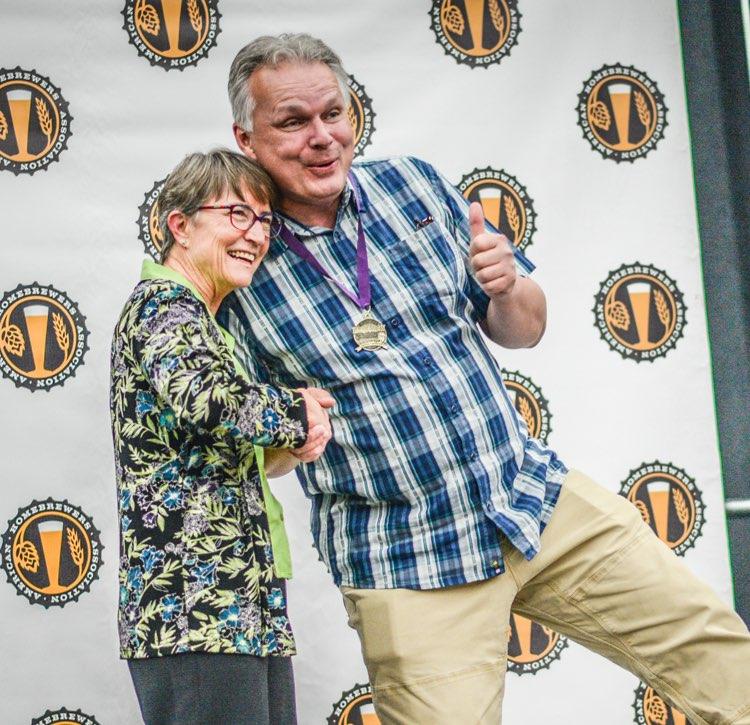 Competition director congratulates winner