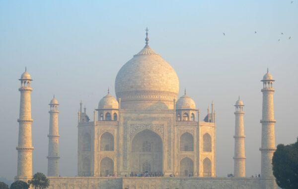 Take the train and marvel at the Taj Mahal