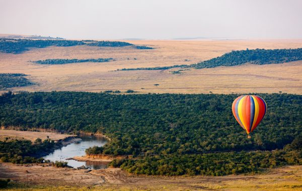 See dawn over the Masai Mara in a hot air balloon