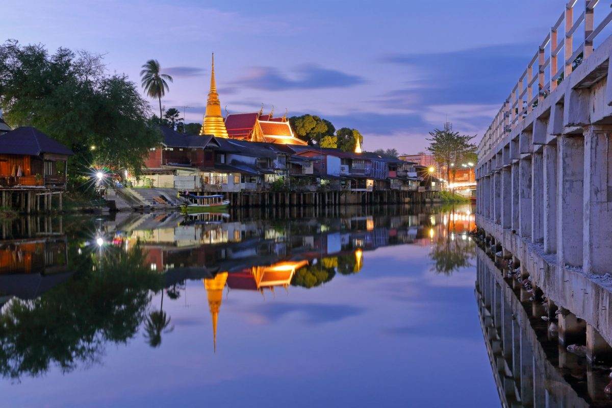 Chanthaboon with landmark with old building village and golden temple in during the night time beautiful and wonderful water reflection at Chanthaburi Province Thailand
