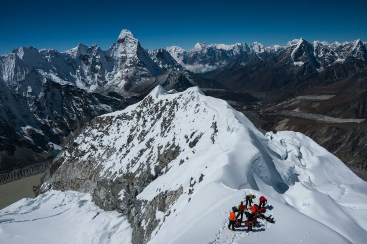 Hiker on Himalayas view from Island Peak trek Nepal