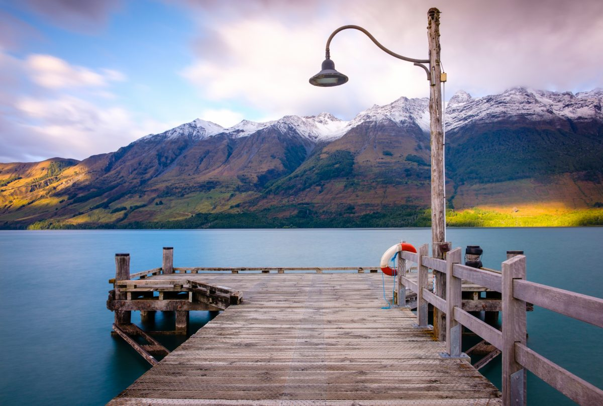 NZ Glenorchy wharf wooden pier and lamp after sunrise