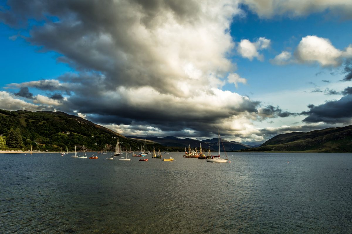 Old Weathered Fishing Boats Anchored In The Harbor Of Ullapool At Loch Broom In Scotland UK