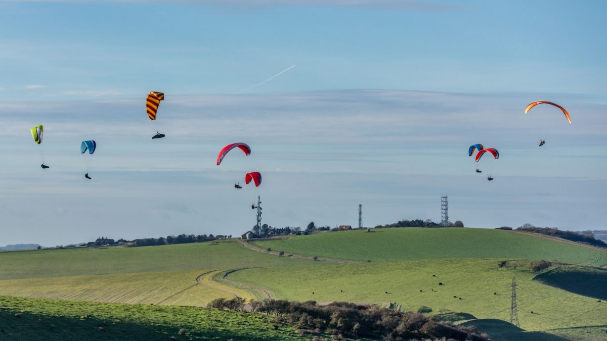 Paragliders over Devils Dyke South Downs Way