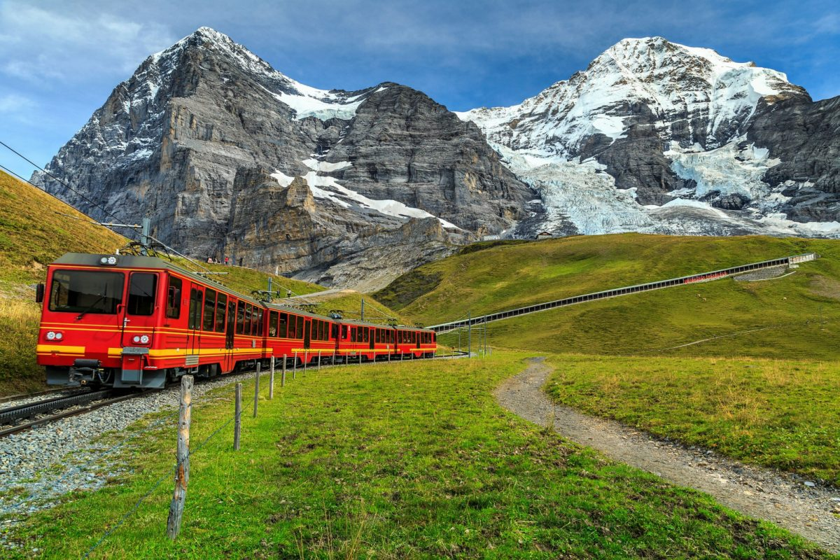 Red train travelling down from Jungfrauloch