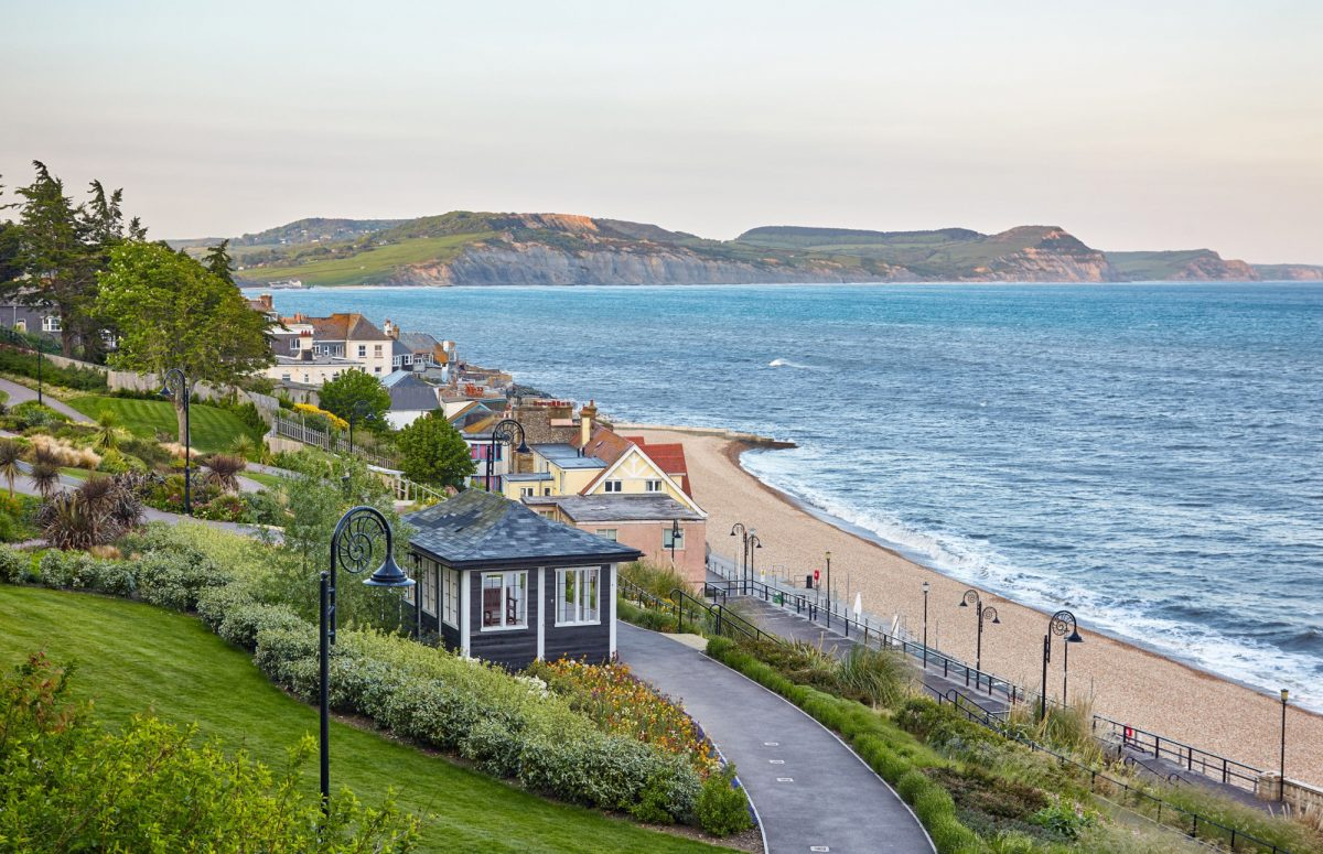 Budget Lyme Regis and Lyme Bay with the Dorset coast including the Golden Cap on the background West Dorset England UK