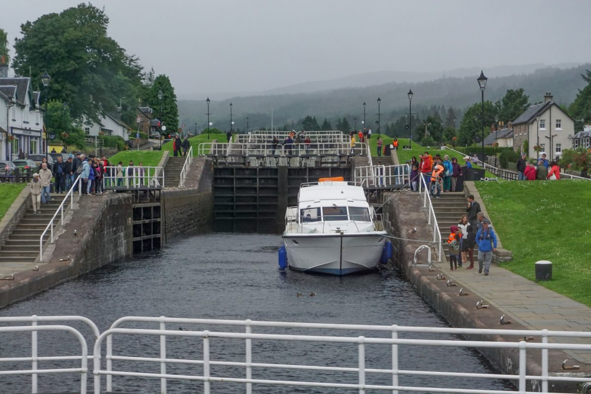 Family Fort Augustus Scotland UK Crowds of people visit the Caledonian Canal locks at the south side of Loch Ness on a cloudy day