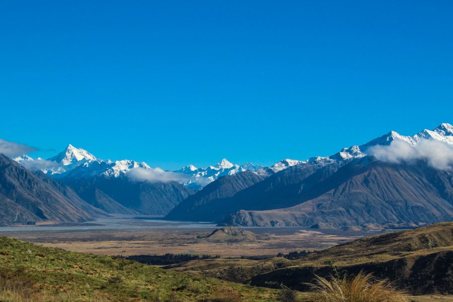 NZ Lake Heron snow capped mountains and hills in Ashburton Lakes District