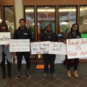 Fairfield University students prepared to take part in a campus demonstration where they were joined by university president Fr. Jeffrey von Arx, S.J., to stand in solidarity with the students of color around the country whose lives were threatened, who feel unsafe or undervalued.