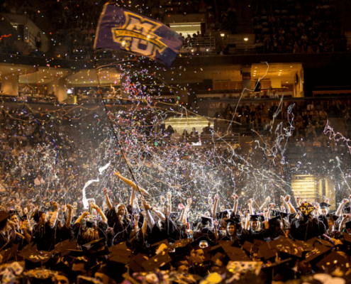 Marquette University graduates celebrate during the 2014 commencement ceremony [Marquette University]