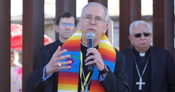 Catholic bishop Mark Seitz at the US-Mexico border wall