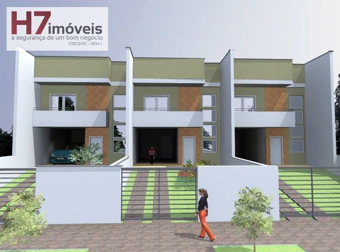 Casa a Venda no bairro Costa e Silva em Joinville - SC. 1 banheiro, 3 dormitórios, 1 suíte, 2 vagas na garagem, 1 cozinha,  área de serviço,  lavabo,