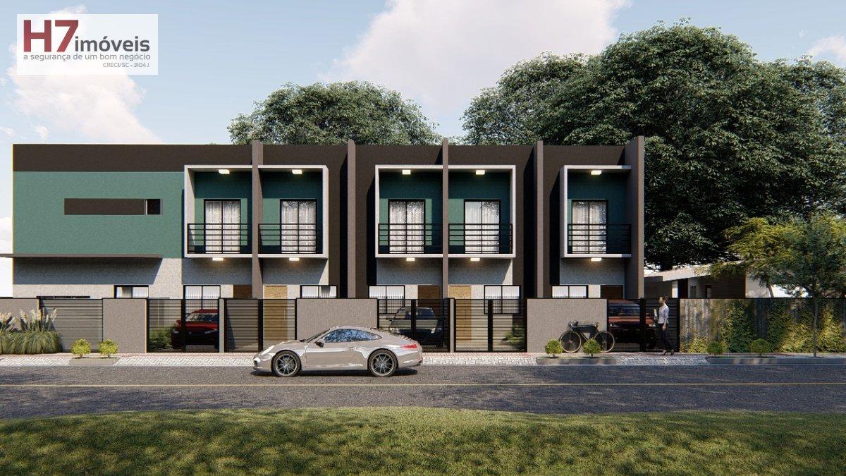 Casa a Venda no bairro Comasa em Joinville - SC. 1 banheiro, 2 dormitórios, 1 vaga na garagem, 1 cozinha,  área de serviço,  lavabo,  sala de tv,  sal