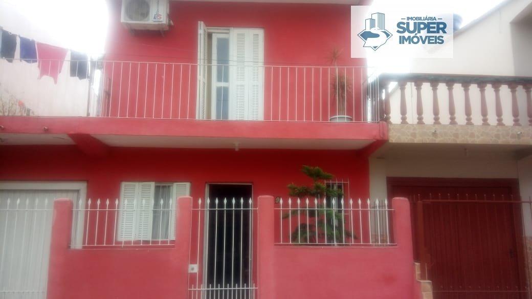 Casa a Venda no bairro Fragata em Pelotas - RS. 3 banheiros, 3 dormitórios, 1 suíte, 1 vaga na garagem, 2 cozinhas,  área de serviço,  sala de estar,