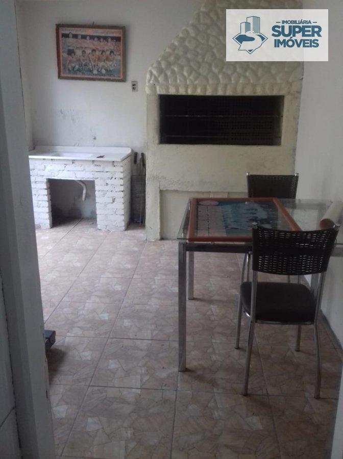 Casa a Venda no bairro Fragata em Pelotas - RS. 2 banheiros, 3 dormitórios, 2 vagas na garagem, 2 cozinhas,  área de serviço,  sala de estar,  sala de