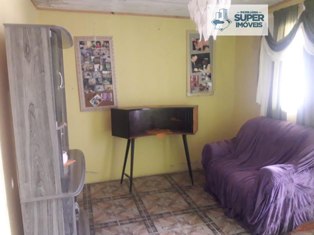 Casa a Venda no bairro Três Vendas em Pelotas - RS. 1 banheiro, 3 dormitórios, 5 vagas na garagem, 1 cozinha,  área de serviço,  sala de estar,  sala