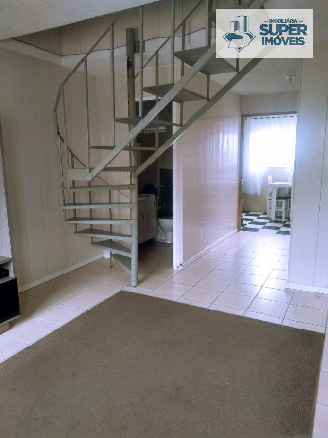 Casa a Venda no bairro Areal em Pelotas - RS. 1 banheiro, 2 dormitórios, 2 vagas na garagem, 1 cozinha,  área de serviço,  sala de estar,  sala de jan