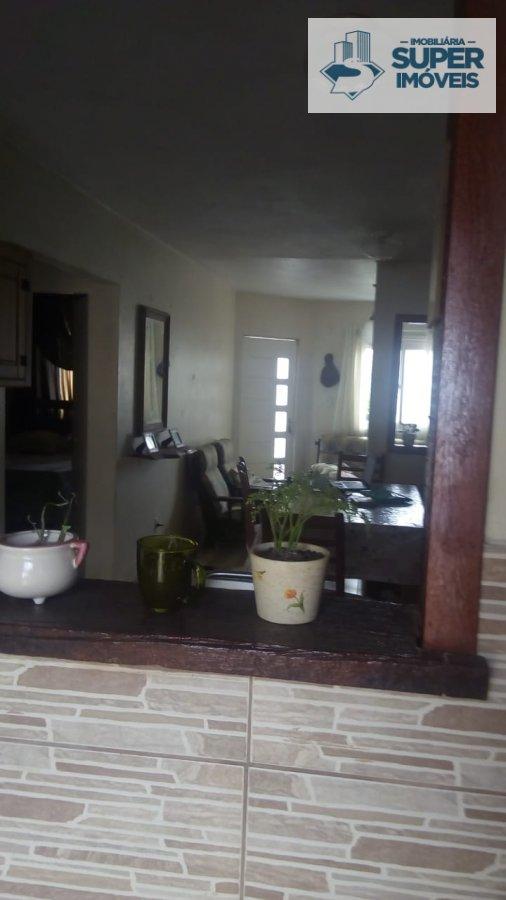 Casa a Venda no bairro Fragata em Pelotas - RS. 2 banheiros, 3 dormitórios, 1 vaga na garagem, 1 cozinha,  área de serviço,  sala de estar,  sala de t