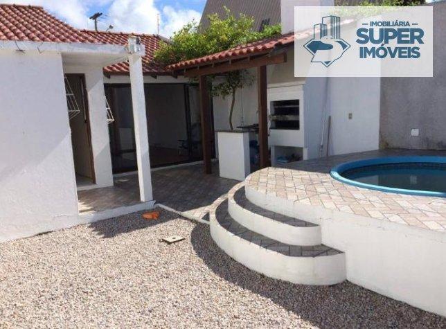 Casa a Venda no bairro Cassino em Rio Grande - RS. 2 banheiros, 3 dormitórios, 1 suíte, 2 vagas na garagem, 1 cozinha,  área de serviço,  sala de esta