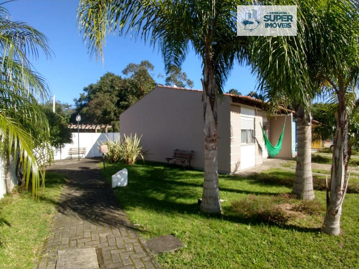 Casa a Venda no bairro Três Vendas em Pelotas - RS. 1 banheiro, 3 dormitórios, 2 vagas na garagem, 1 cozinha,  área de serviço,  sala de estar,  sala