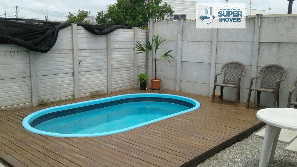 Casa a Venda no bairro São Gonçalo em Pelotas - RS. 2 banheiros, 3 dormitórios, 1 suíte, 2 vagas na garagem, 1 cozinha,  closet,  área de serviço,  sa