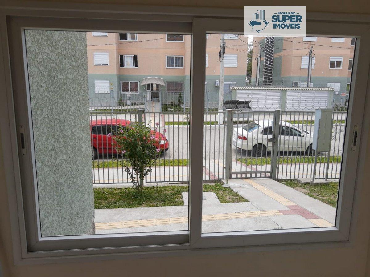 Apartamento a Venda no bairro Três Vendas em Pelotas - RS. 1 banheiro, 2 dormitórios, 2 vagas na garagem, 1 cozinha,  área de serviço,  sala de estar,