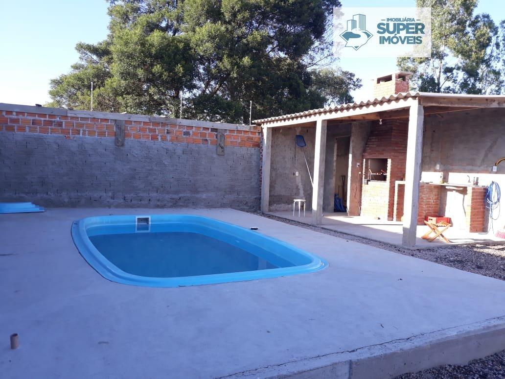Casa a Venda no bairro Centro em Capão do Leão - RS. 1 banheiro, 2 dormitórios, 1 vaga na garagem, 1 cozinha,  área de serviço,  sala de estar,  sala