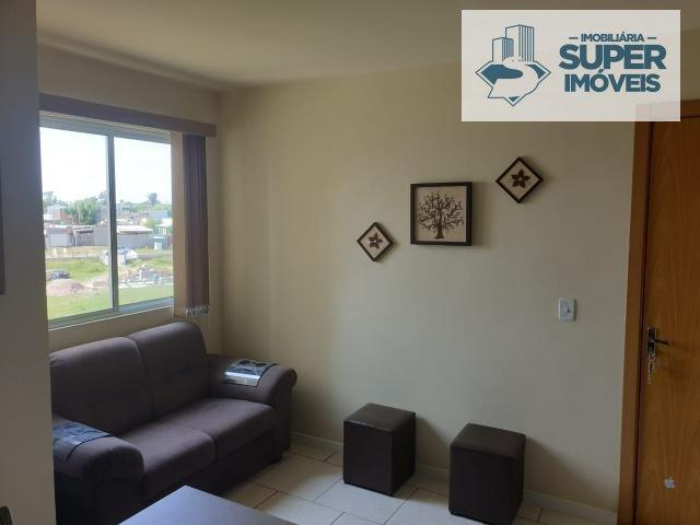 Apartamento a Venda no bairro Vila Rural em Rio Grande - RS. 1 banheiro, 2 dormitórios, 1 vaga na garagem, 1 cozinha,  área de serviço,  sala de estar