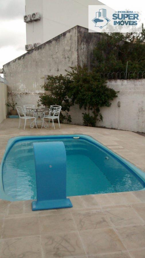 Casa a Venda no bairro Areal em Pelotas - RS. 1 banheiro, 3 dormitórios, 1 vaga na garagem, 1 cozinha,  área de serviço,  sala de estar,  sala de tv,