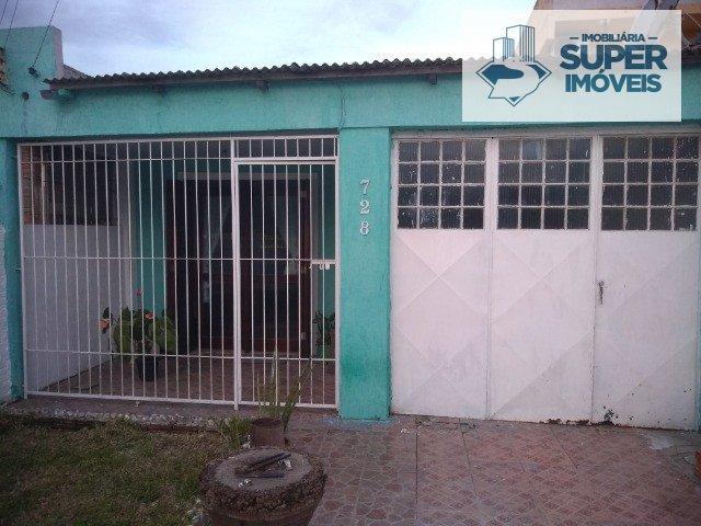 Casa a Venda no bairro Areal em Pelotas - RS. 2 banheiros, 3 dormitórios, 1 suíte, 2 vagas na garagem, 1 cozinha,  sala de estar.  - 1183