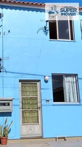Sobrado a Venda no bairro Areal em Pelotas - RS. 1 banheiro, 2 dormitórios, 1 vaga na garagem, 1 cozinha,  área de serviço,  sala de estar,  sala de j
