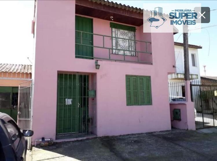 Sobrado a Venda no bairro Areal em Pelotas - RS. 3 banheiros, 3 dormitórios, 1 cozinha,  área de serviço,  copa,  sala de estar,  sala de jantar.  - 1