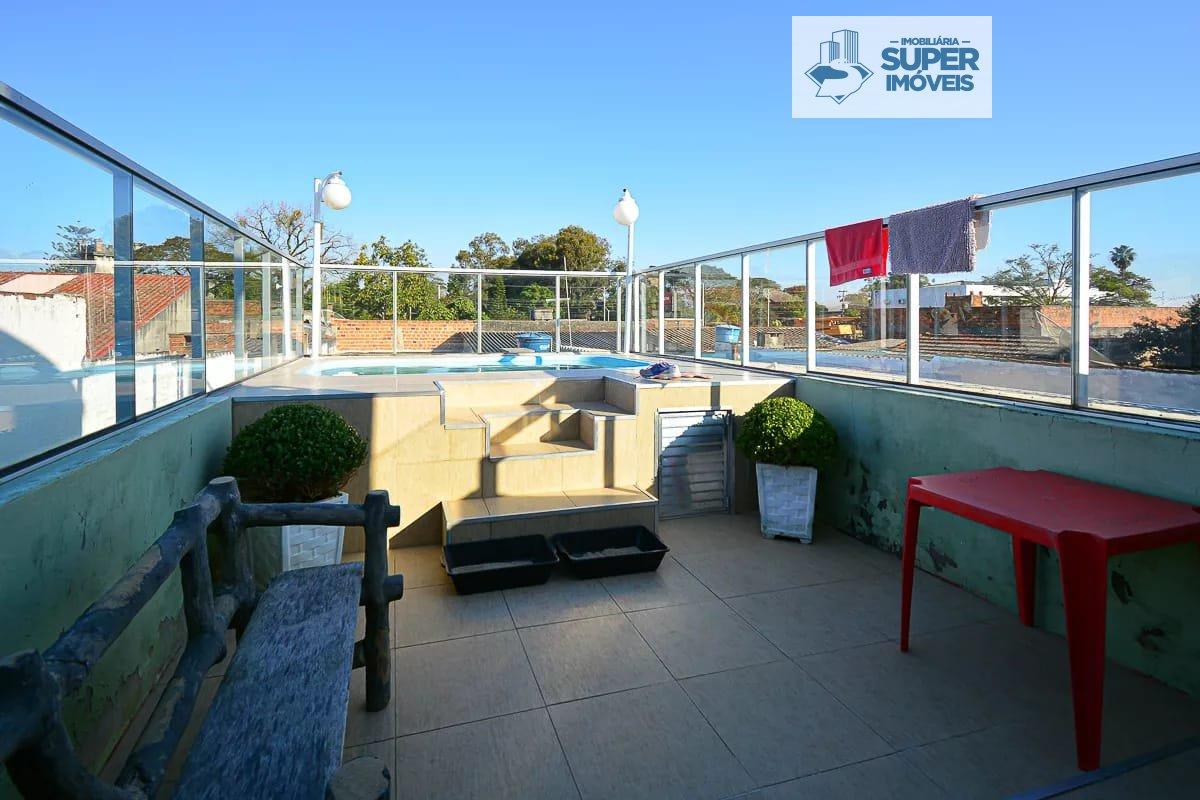 Casa a Venda no bairro Fragata em Pelotas - RS. 3 banheiros, 4 dormitórios, 1 vaga na garagem,  área de serviço,  sala de estar,  sala de jantar.  - 1