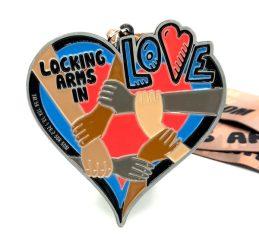 Locking Arms in Love 1M 5K 10K 13.1 26.2 registration logo