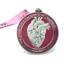 The Human Heart 1M 5K 10K 13.1 26.2 registration logo