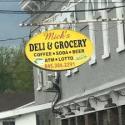 Mick's Deli & Grocery logo