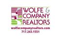 Wolfe & Company Realtors logo