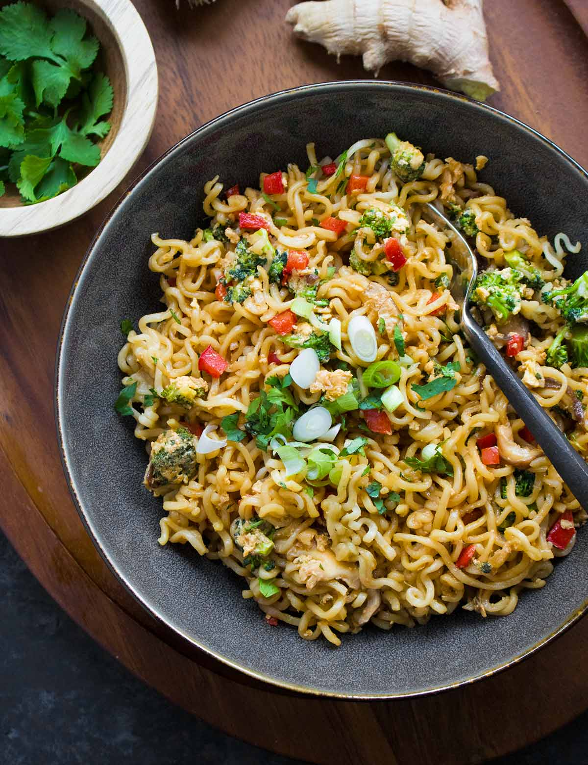 Ramen Noodle Stir Fry in a dark gray bowl with a fork