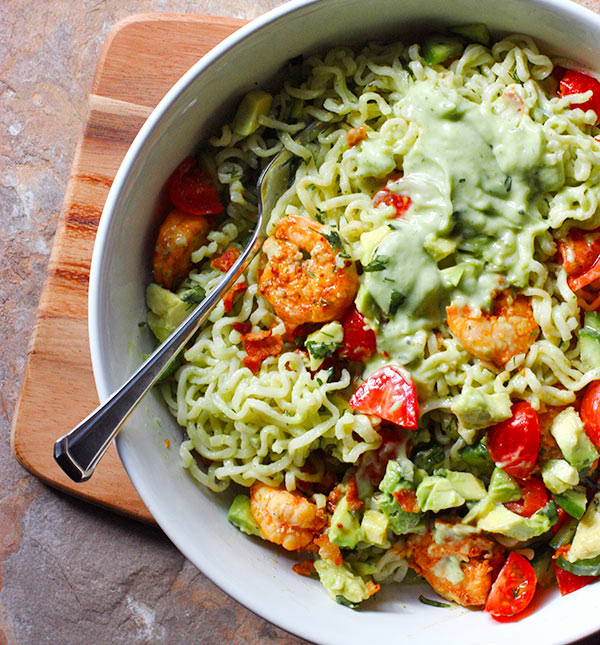 Ready to eat Spicy Shrimp and Saucy Guacamole Ramen Noodle Bowl with a fork.