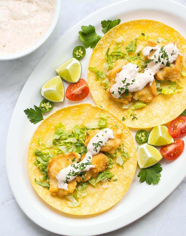Fish tacos with homemade fish taco sauce. Recipe at SoupAddict.com