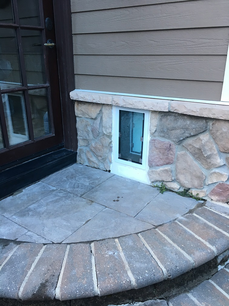 Stone veneer wall install by The Door Center