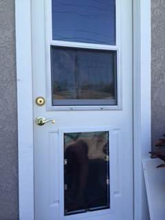 Hale Pet Door Installed In a Door Under a Window