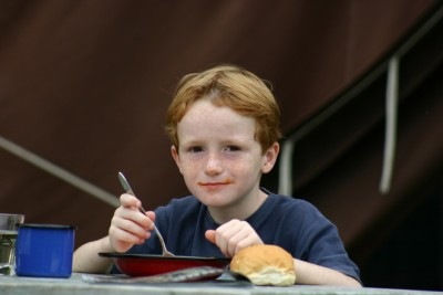 kid eating soup
