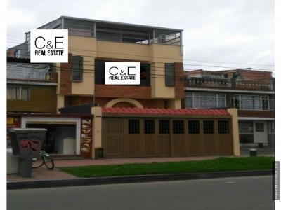 Vendo casa de tres pisos en Bogotá con local doble y garaje doble