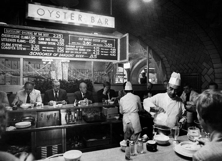 Photo of Chef Tom Sato working at the Oyster Bar. Image appeared in the New York Times in 1974, before the restaurant closed.