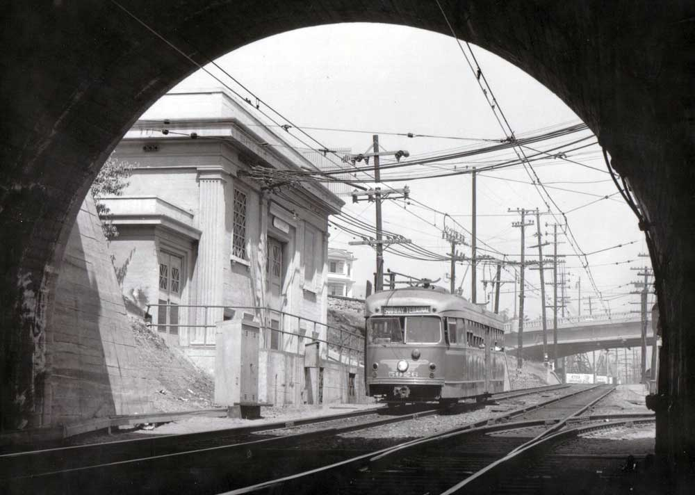 Pacific Electric PCC streetcar no. 5026 is about to leave daylight as it enters the tunnel to the Subway Terminal Building in downtown Los Angeles. Image: Pacific Electric