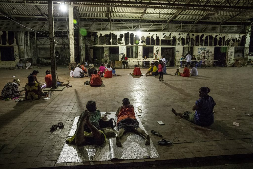 People play Bingo in the abandoned building of a Tea Shop in Arijejen District. Bingo is one of the most popular betting games in the country and many Nauruan people spend their evenings and weekends playing and trying to make some money. 90% of the population is unemployed. Image by Vlad Sokhin